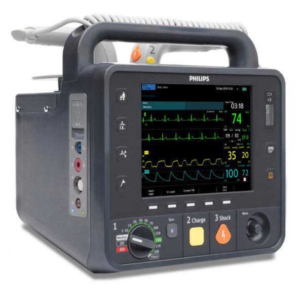 Der Philips Heartstart Intrepid ist Monitor und Defibrillator in einem Gerät. Die Bedienelemente und das Display mit der Kurvendarstellung der Vitalparameter sind in dieser Frontalansicht des HeartStart Intrepid zusehen.